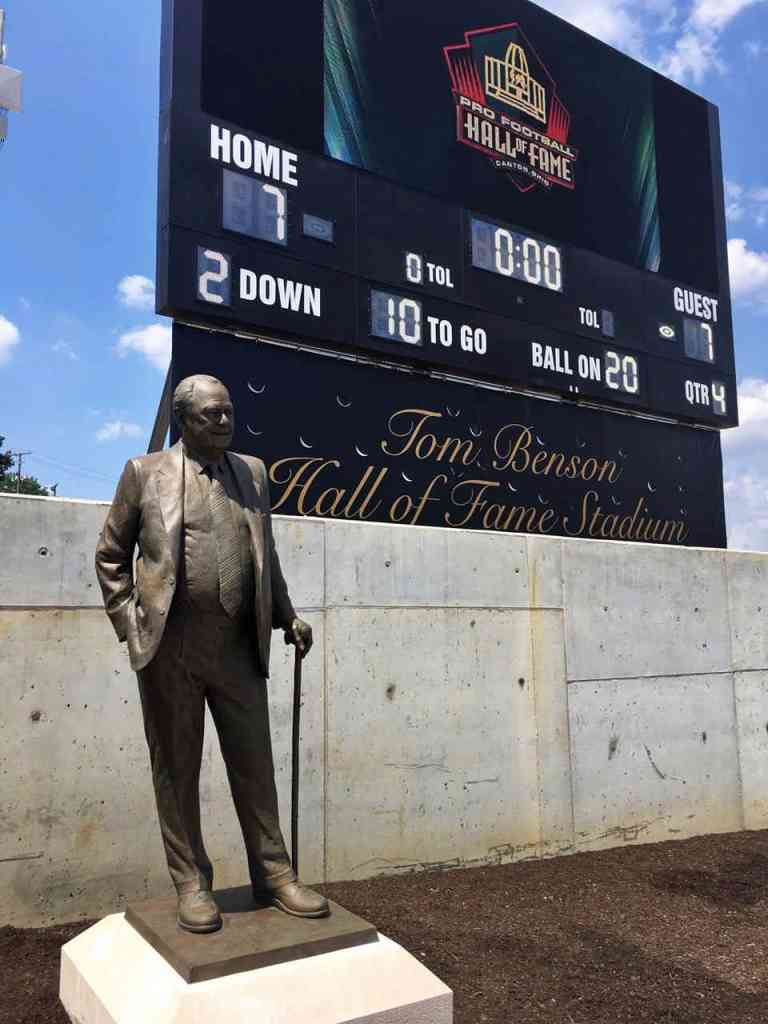 The spectacular Tom Benson Hall of Fame Stadium was dedicated during a ceremony this morning that included the unveiling of a larger-than-life sized likeness of Tom Benson, the owner of the New Orleans Saints.