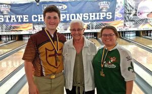 Brother Martin senior Cody Schaffer and Archbishop Chapelle sophomore Sarah Rubi with coach Betty Chien