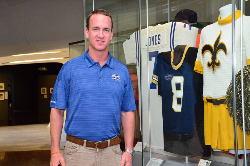 Peyton at LSHOF with Archie jersey
